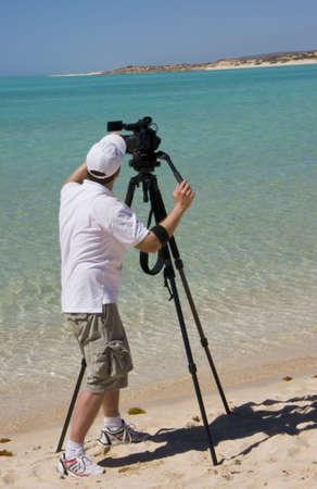 Videographer on the beach.