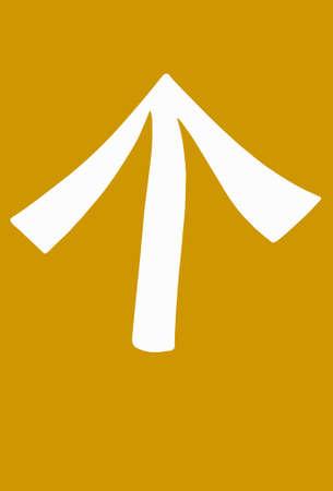Signage: white arrow on yellow background.