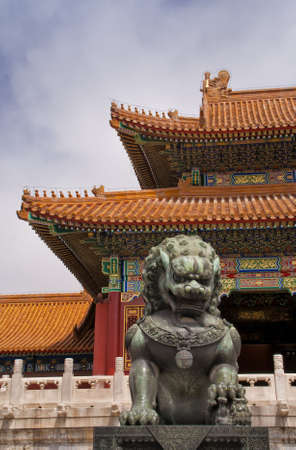 Beijing Forbidden City: lion against the corner of a roof. Stock Photo