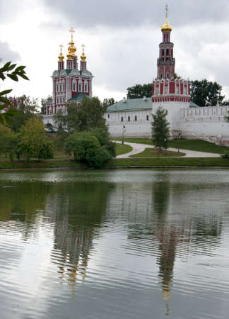 Novodevichy Convent reflects in the lake - portrait style. Stock Photo