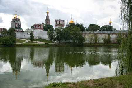 Novodevichy Convent reflects in the lake - landscape style.