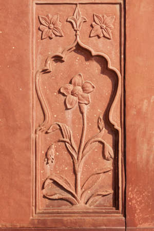 Flower stone carving in red sandstone at the Red Forts Drum House. photo