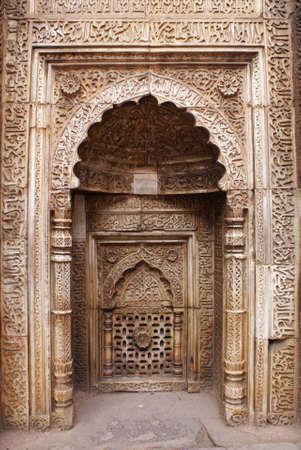 minar: Multiple frames and gates around alcove at Qutb Minar in Delhi. Stock Photo