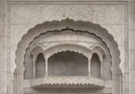 Outside balcony carved in white marble at New Delhis Sikh temple.