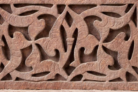 Close up of red stone carving at Qutb Minar in Delhi. photo