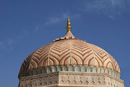 Overly decorated Hindu dome with golden tip at Jaipur's Amber Palace.
