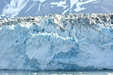 impregnable: Typical azure blue shine of glacier ice topped by grey white snow cones.