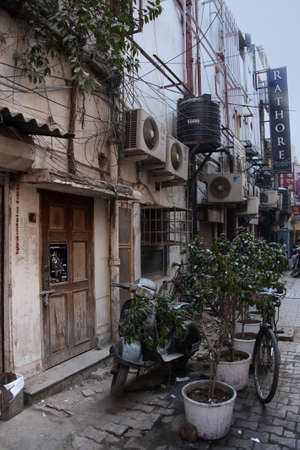 supposed: Khan Market in New Delhi - March 2011 - Utilities (electrical, airco, water, cable. etc) disfigure the front of businesses in what is supposed to be an upscale neighborhood Editorial