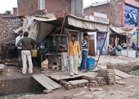 Indian city of Agra - February 2011 - Fast food Restaurant built over sewer on street market.