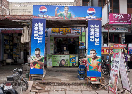 Indian city of Agra - February 2011 - Pepsi Cola uses heroes of Indian Cricket team in advertisement at small food stores. Stock Photo - 10499975