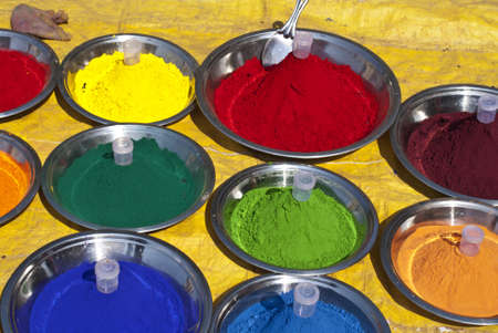 Traditional Hindu religious practices make color pastes to apply on body.