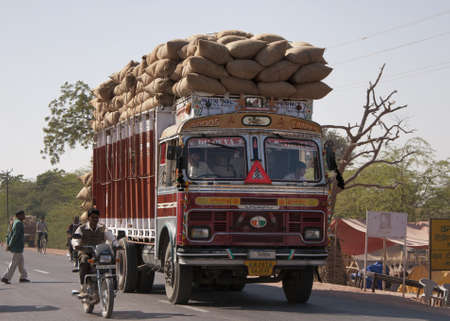 Nagaur in Rajasthan India - February 2011 - Overloaded dump truck filled with jute bags on the road. Stock Photo - 10500297