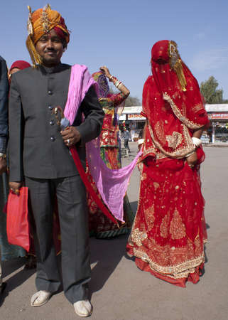 Deshnoke in Rajasthan India - February 2011 - Hindu Groom brings his veiled trophy wife - bride - home on a leash. Stock Photo - 10500295