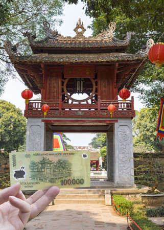 The 100,000 Dong note features Constellation of Literature Pavilion  Combination shot in the park  Stock Photo - 13789298
