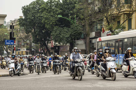 Vietnam Hanoi - March 2012: Overwhelming number of motorbikes downtown.