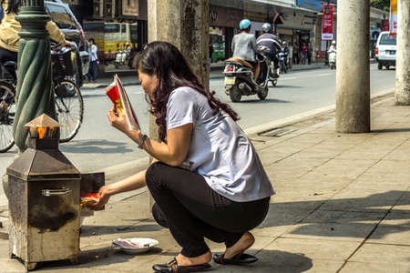 fake money: Vietnam Hanoi - March 2012: Burning fake money to please the commercial spirits.