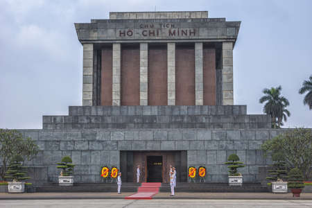 Vietnam Hanoi - March 2012: Close up of Ho Chi Minh mausoleum with guards and flowers.