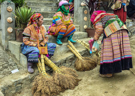 sunday market: Hmong women selling brooms on Sunday market. Colorful appearance. Editorial