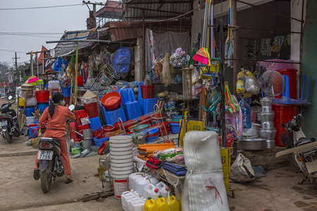 Duong Lam, Vietnam  - March 8,2012: Household hardware shop in rural area. Colorful picture thanks to reds, blues and more of plastics. Editöryel