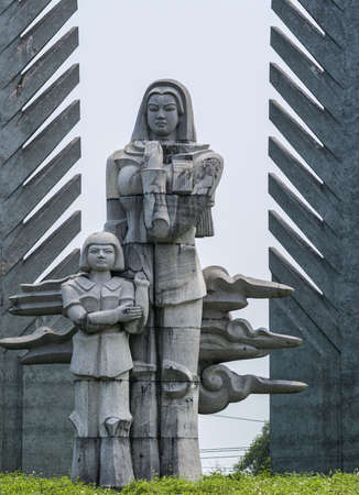downcast: Vietnam - DMZ: detail of war memorial showing mother and child. Editorial