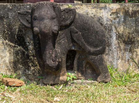 bas relief: Vietnam, Damaged elephant statue on bas relief of Chien Dam Cham tower. Stock Photo