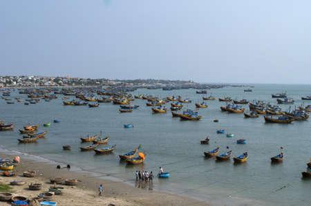 fishing fleet: Vietnam Mui Ne village - March 2012: The fishing fleet of Mui Ne village anchored just off shore.