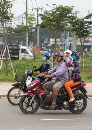 Three or more passengers on a motorbike is common, and the children dont carry any helmet.