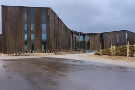 saami: Parliament of Finland s Sami people stands in Inari  Dark brown wooden construction stands as tall trees in the forests and houses the representative body of the Sami people, living in Finland