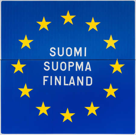 saami: Sign in Utsjoki, northern Lapland, on the border with Norway spells the name of Finland in Finnish, in Saami language and in English  All on the classic European blue background with golden stars