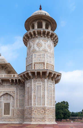 Marble minaret of Agra s Baby Taj mausoleum in India  White marble decorated tower against blue skies  Stock fotó
