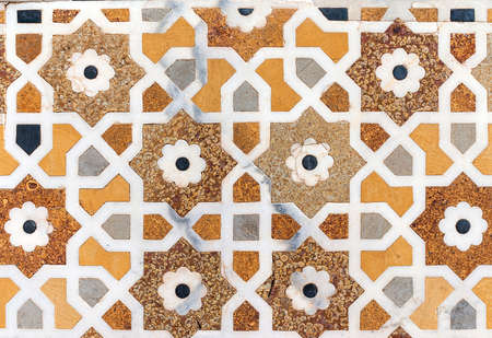 corpse flower: Detail of marble lay-in work at Agra s Baby Taj mausoleum in India  Octagons, white lines, flower motives, brown and amber make a great combination  Stock Photo
