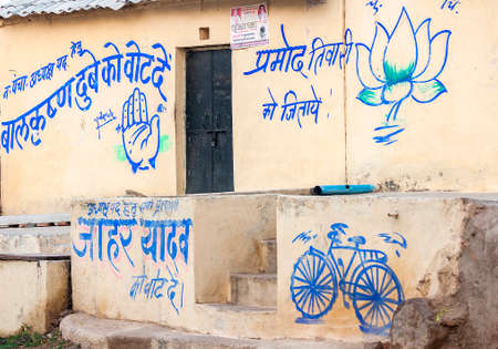 Hand = INC, India National Congress Party; Lotus = BJP, Bharatiya Janata Party; bicycle = SP, Socialist Party. Editorial