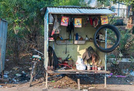 subsist: KHAJURAHO, INDIA - CIRCA FEBRUARY 2011  Typical bike repair shop along the road in rural India