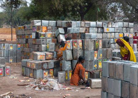 reprocess: VARANASI, INDIA - CIRCA FEBRUARY 2011  Recycling operation of empty metal food cans  Editorial