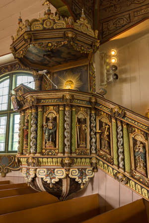 Tornio, Finland - June 2012: Painted wood carvings decorate the centuries old pulpit. The style is late Renaissance or early Baroch. The local Mr. Niilo Jaakonpoika Fluur created the pulpit in the late 17th century.