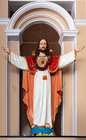 With arms spread this statue welcomes the worshiper inside the Catholic Sacred Heart Church of Bengaluru