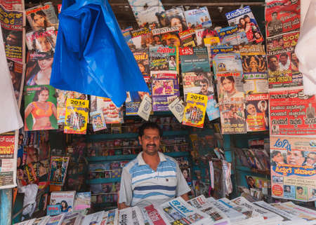 karnataka: BANGALORE, INDIA - CIRCA OCTOBER 2013  Magazine and newspaper stand in old town  The language of most magazines is Kannada, the language of Karnataka State, of which Bangalore is the capital