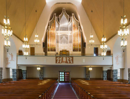 possesses: Organ consecrated in 1987 holds 4000 pipes and possesses 45 registers, at Rovaniemi main church  Part of ceiling and church interior also in photo  Editorial
