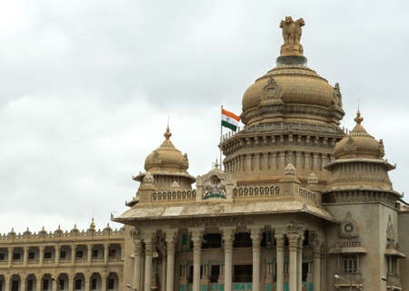 Ashoka Chakra, Indian flag, State Coat of Arms and State s slogan all on top of the main entrance to the Vidhana Sabha in Bangalore