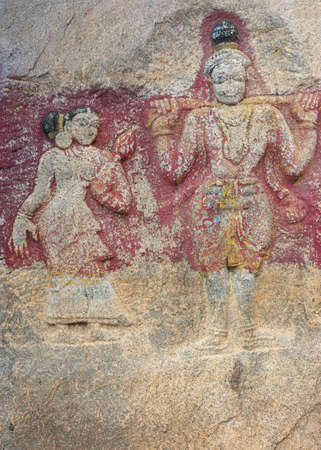 parvati: Millennium-old slab of rock with decoration at Sri Naheshwara in Bangalore  Worn off colors remain  Editorial