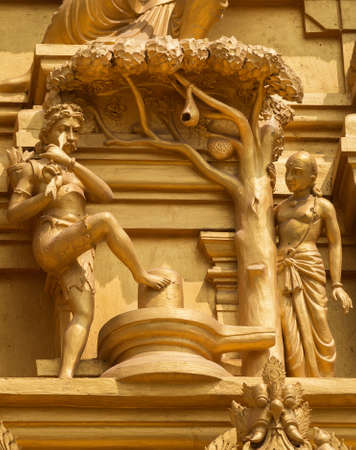 donates: Statue on the golden temple tower of Sri Naheshwara in Bengaluru depicts Kannappa Nayanar, the hunter that donates his eyes to honor Lord Shiva  Editorial