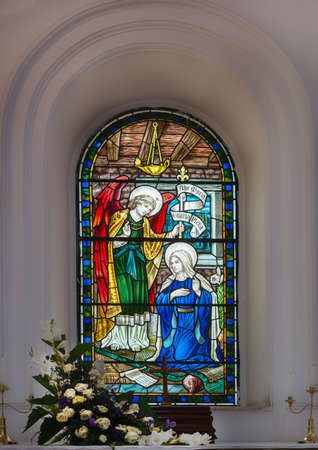 angel gabriel: Stained glass window depicting Angel Gabriel bringing the message to Mary of her becoming the mother of Jesus, at the Anglican Saint Mark s Cathedral in Bangalore  Editorial