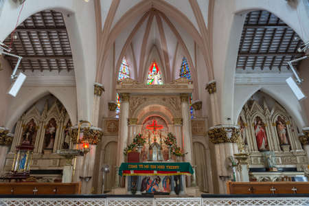 The chancel and altar area with many statues and bas-relief at the Catholic Saint Mary s Basilica in Bangalore
