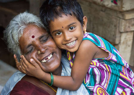 THIRUVANNAMALAI, INDIA - CIRCA OCTOBER 2013: The love between grandmother and granddaughter. Editorial