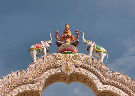Goddess Lakshmi on top of the entrance gate at Sripuram, the Golden Temple, in Vellore, Tamil Nadu, India