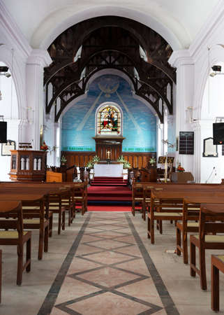 Looking from the nave to the chancel and altar at Protestant Holy Trinity church in Bangalore