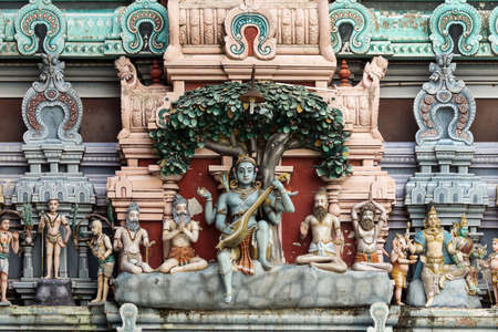 Dhakshinamoorthy statue on the gopuram of Rathinagiri Hill Temple in Vellore, Tamil Nadu, India  Dhakshinamoorthy is an avatar of Shiva when he changed the name of his future wife Parvati  Stock Photo
