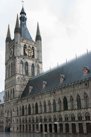 ypres: IEPER, BELGIUM - CIRCA MARCH 2014: Belfry of Ypres (Ieper) with Flanders Fields Museum.