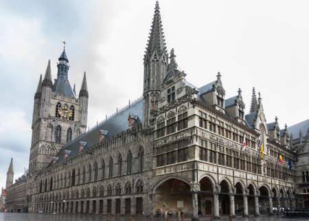 ypres: IEPER, BELGIUM - CIRCA MARCH 2014: Historic Belfry and town hall in the center of Ypres on a rainy afternoon.