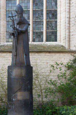 beguin: KORTRIJK, BELGIUM - CIRCA MARCH 2014  Statue of Paul Goethals, first archbishop of Kolkata, India, stand near the St  Martin  Maarten  Church in Kortrijk, Belgium